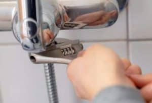 How to Install a New Shower Head - grab wrench